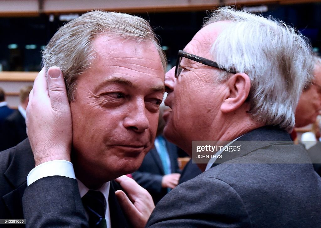 UK Independence Party (UKIP) leader Nigel Farage (L) talks with EU Commission President Jean-Claude Juncker before a plenary session at the EU headquarters in Brussels on June 28, 2016. European Commission chief Jean-Claude Juncker called on June 28 on Prime Minister David Cameron to clarify quickly when Britain intends to leave the EU, saying there can be no negotiation on future ties before London formally applies to exit. / AFP / JOHN
