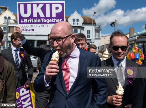 UK Independence Party leader Paul Nuttall and the party's candidate for the Clacton constituency Peter Oakley eat an ice cream as they campaign in...