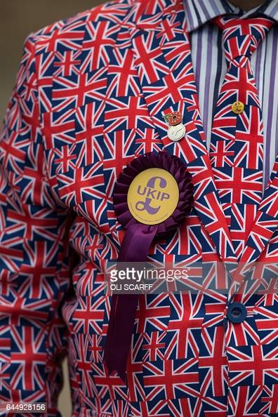 UK Independence Party member Mark Childs wears a party rosette on a Union Flag suit outside the campaign office for UKIP Leader Paul Nuttall...