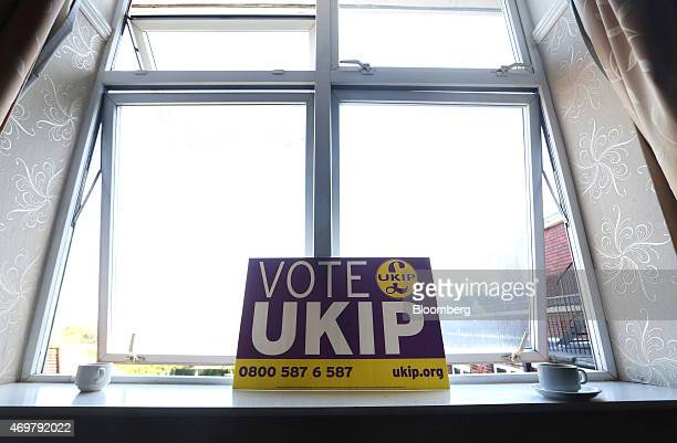 A UK Independence Party poster sits on a window ledge along with discarded tea cups during the launch of the party's 2015 general election manifesto...