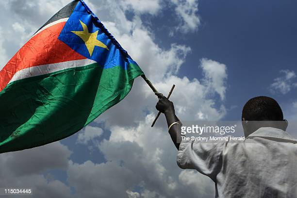 Independence referendum Southern Sudan A South Sudanese man carries a South Sudan flag after taking to the streets of Juba marching for an...