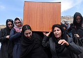 Independent Afghan civil society activist women carry the coffin of Farkhunda who was lynched by an angry mob in central Kabul on March 22 2015...