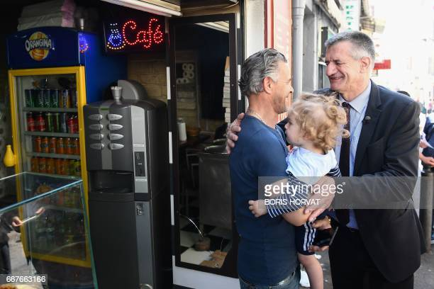 Independent candidate for the 2017 presidential elections Jean Lassalle salutes people during his visit in Marseille southern France on April 12 2017...
