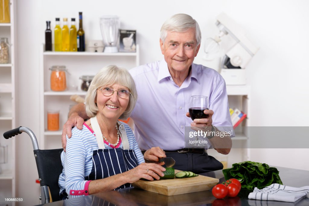 Independent Handicapped Senior and Partner Preparing Healthy Meal : Stock Photo