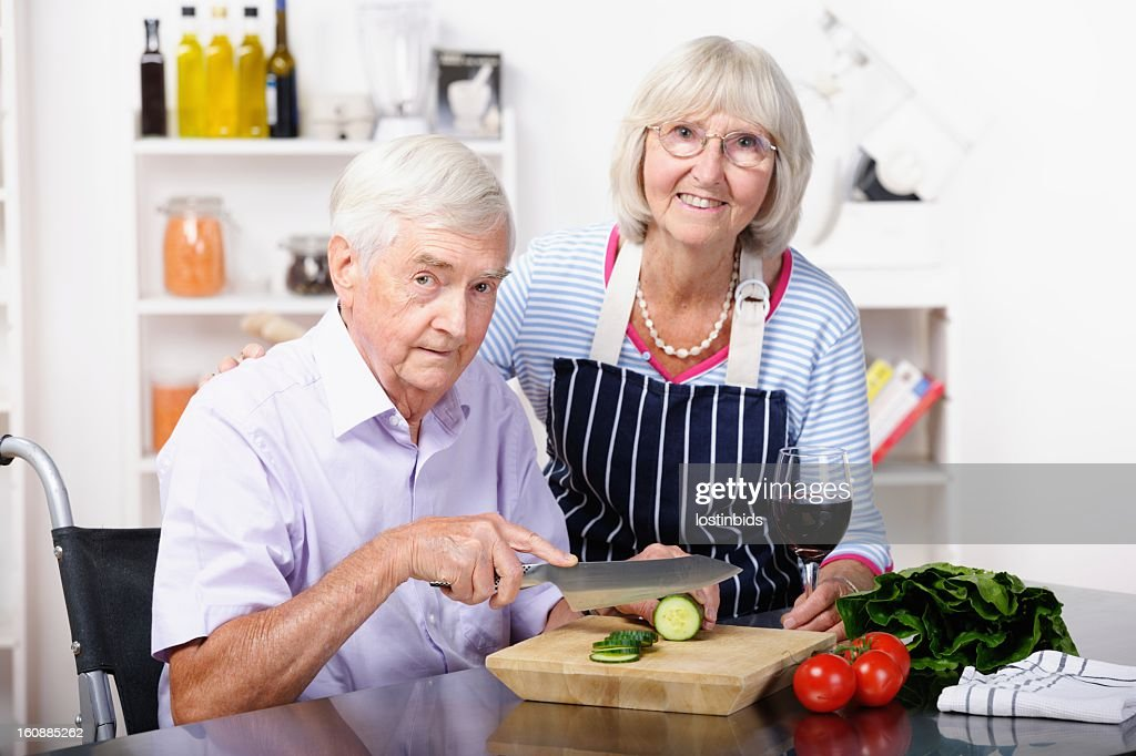 Independent Handicapped Senior Man and Partner Preparing Healthy Meal : Stock Photo