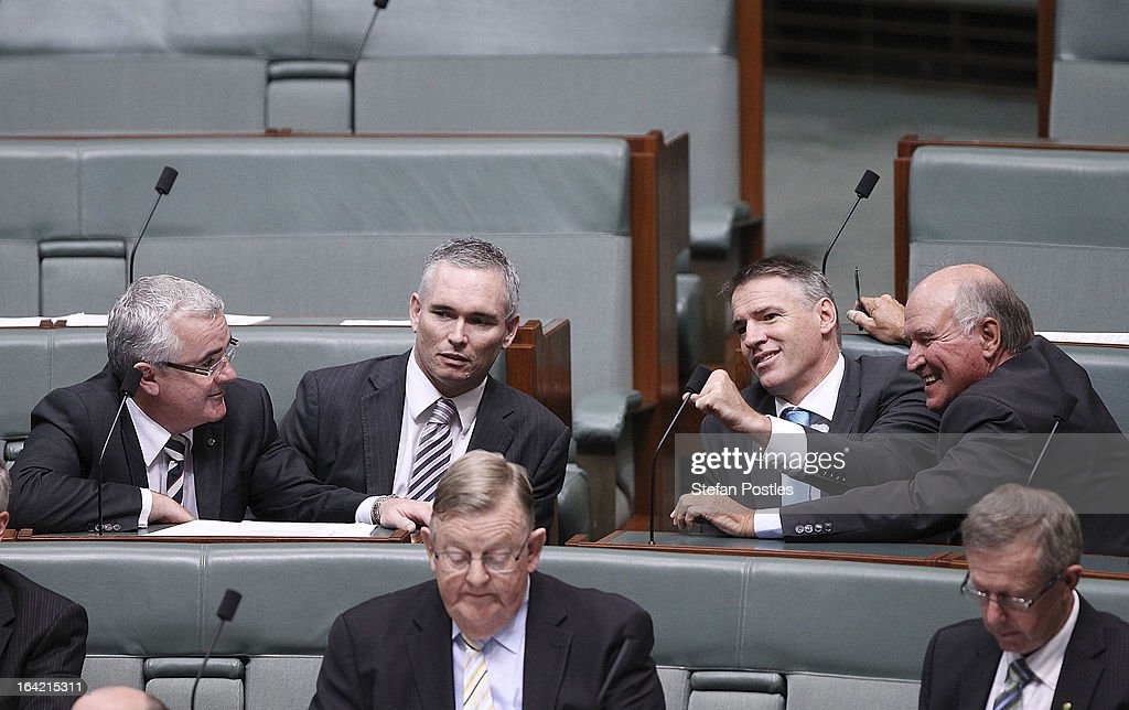 Independent MPs Andrew Wilkie, Craig Thompson, <a gi-track='captionPersonalityLinkClicked' href=/galleries/search?phrase=Rob+Oakeshott&family=editorial&specificpeople=7151369 ng-click='$event.stopPropagation()'>Rob Oakeshott</a> and Tony Windsor during House of Representatives talk amongst themselves during question time on March 21, 2013 in Canberra, Australia. Australian Prime Minister Julia Gillard has called for a ballot today to decide the leader, and deputy leader of the Australian Labor Party, effectively a caucus vote that will decide the Prime Minister and Deputy Prime Minister of the country. Kevin Rudd is expected to nominate for the leadership and Simon Crean for the deputy position. Rudd, who was elected Prime Minister in the 2007 election was ousted by Gillard in June 2010, who then went on to win the 2010 Federal Election in August.