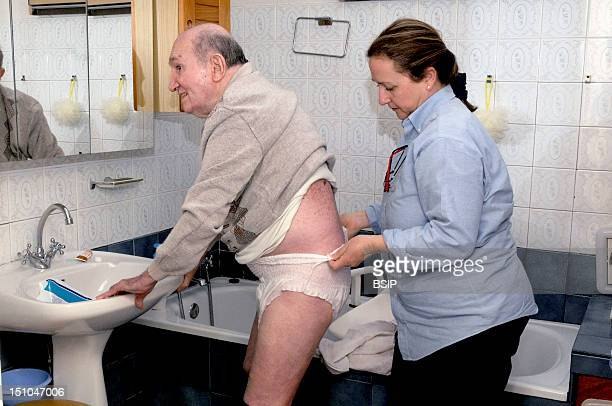 Independent Nurse In Venissieux France Patient Care Presenting An Alteration Of Mobility Motor Handicap Following A Cerebral Vascular Accident