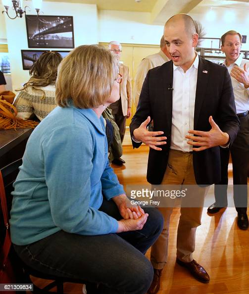 S independent presidential candidate Evan McMullin talks to a supporter at the Brick House Cafe on November 5 2016 in Cedar City Utah McMullin is...
