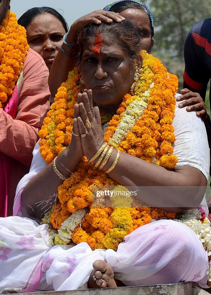 Independent transgender candidate Bashir Kinnar alias 'Kamala Kinnar' gestures to supporters on the way to file nomination papers for the Lok Sabha Elections in Varanasi on April 19, 2014. India's 814-million-strong electorate is voting in the world's biggest election which is set to sweep the Hindu nationalist opposition to power at a time of low growth, anger about corruption and warnings about religious unrest.