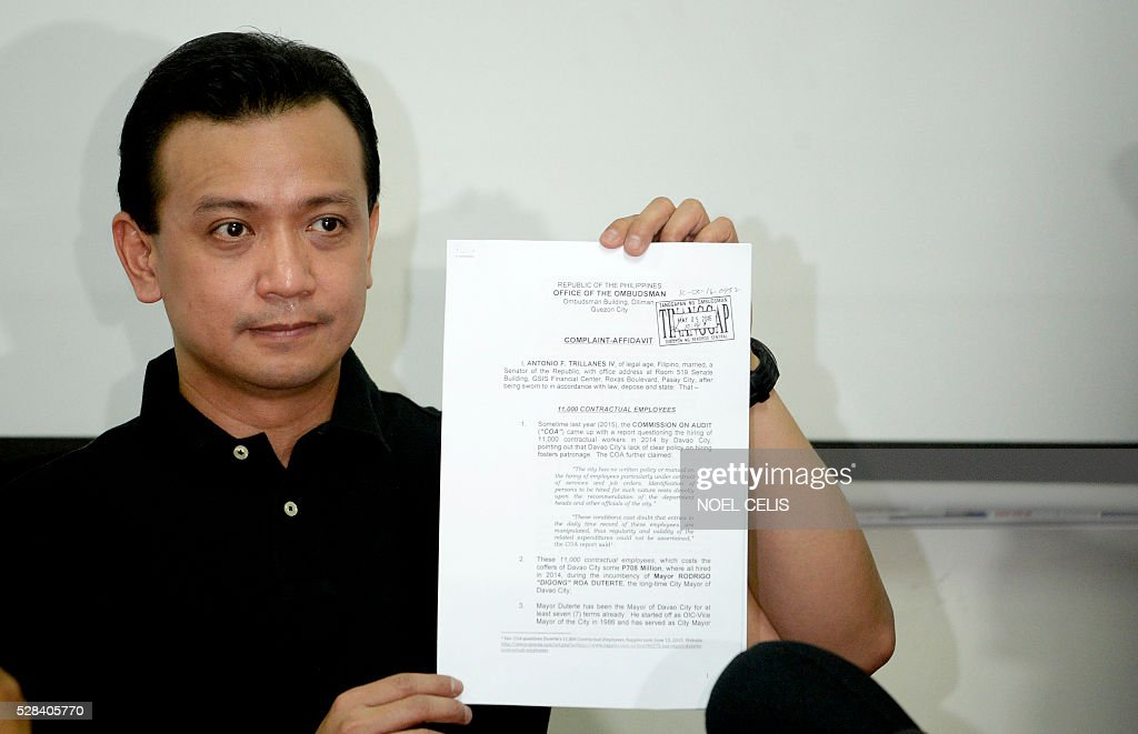 Independent vice presidential candidate Antonio Trillanes shows a plunder charges that he will file against presidential candidate and Davao Mayor Rodrigo Duterte, during a press conference at the Magdalo headquarters in Manila on May 5, 2016. Anti-establishment Philippine politician Rodrigo Duterte's rollicking ride to presidential favouritism has triggered warnings of a coup should he win next week's election, with opponents warning he is a dictator in the making. Trillanes said some in the military��were 'strongly averse' to Duterte's long-standing ties with communists, and that a coup was 'very likely'. / AFP / NOEL