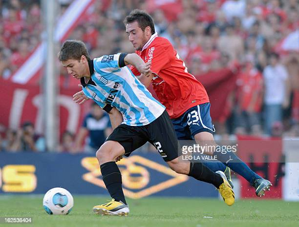 Independiente's defender Federico Mancuello vies for the ball with Racing Club's forward Luciano Vietto during their Argentine First Division...