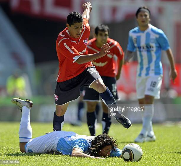 Independiente's midfielder Fernando Godoy vies for the ball with forward Pablo Lugercio of Racing during their Argentina's first division football...