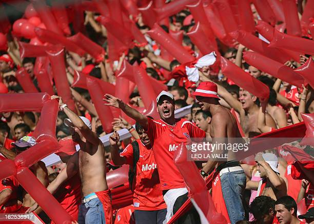 Independiente's supporters cheer the team after the Argentine First Division football match against Racing Club at the Libertadores de America...