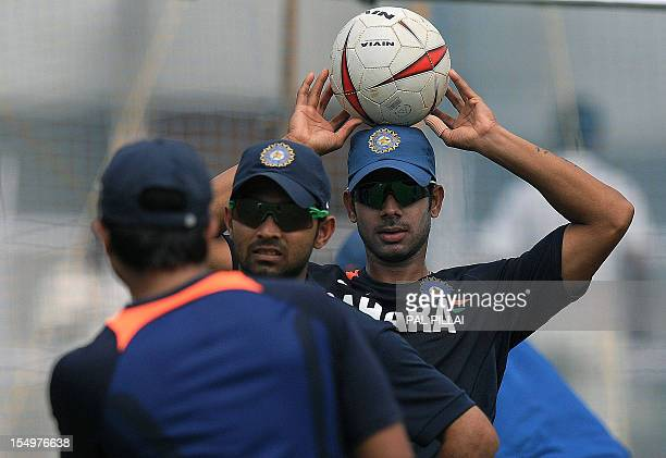 India A cricketer Manoj Tiwary tries to balance a football on his head during a training session at the Cricket Club of India in Mumbai on October 29...