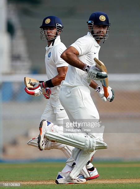 India A cricketers Manoj Tiwary and Irfan Pathan in action during a warmup cricket match against England at Brabourne stadium on October 30 2012 in...
