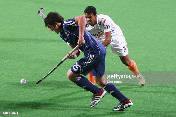 India and France players vie for the ball during the men field hockey match between India and France for the final position of the FIH London 2012...