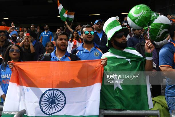 India and Pakistan fans cheer their teams during the ICC Champions trophy cricket match between India and Pakistan at Edgbaston in Birmingham on June...