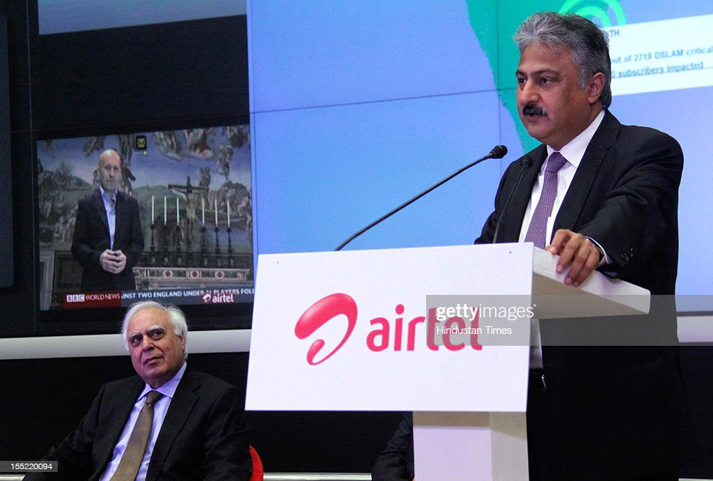 CEO India and South Asia of Airtel Sanjay Kapoor addressing during launch of network experience centre (NEC) at Manesar as Telecom Minister Kapil Sibal looks on October 31, 2012 in Gurgaon, India. Network Experience Centre (NEC) will monitor its various services like mobile, fixed line and DSL broadband, DTH, M-commerce, enterprise, international cable systems and internet peering points across India and South Asia from a single location.