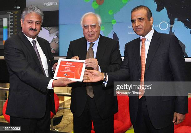CEO India and South Asia of Airtel Sanjay Kapoor Telecom Minister Kapil Sibal and Bharti Airtel Chairman Sunil Bharti Mittal during during launch of...