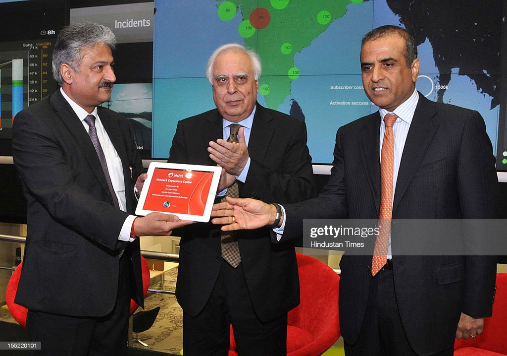 CEO India and South Asia of Airtel Sanjay Kapoor , Telecom Minister <a gi-track='captionPersonalityLinkClicked' href=/galleries/search?phrase=Kapil+Sibal&family=editorial&specificpeople=791656 ng-click='$event.stopPropagation()'>Kapil Sibal</a> and Bharti Airtel Chairman Sunil Bharti Mittal during during launch of network experience centre (NEC) at Manesar on on October 31, 2012 in Gurgaon, India. Network Experience Centre (NEC) will monitor its various services like mobile, fixed line and DSL broadband, DTH, M-commerce, enterprise, international cable systems and internet peering points across India and South Asia from a single location.