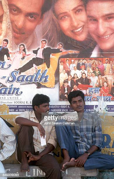 India Andaman and Nicobar Islands Port Blair two men relaxing under movie poster