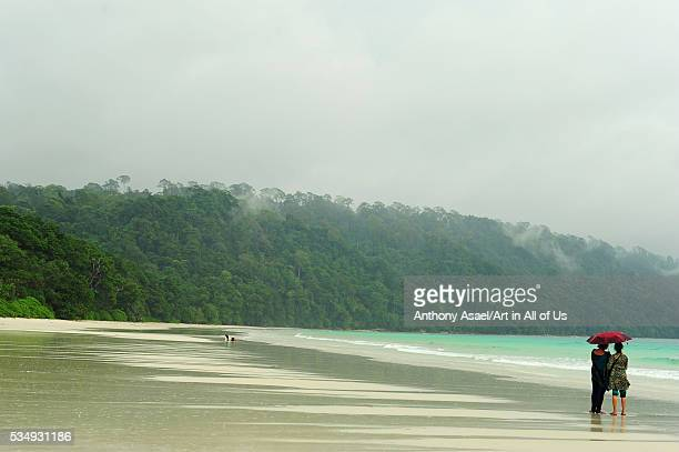 India Andaman Islands Havelock Indian tourist below umbrella on beach number 7