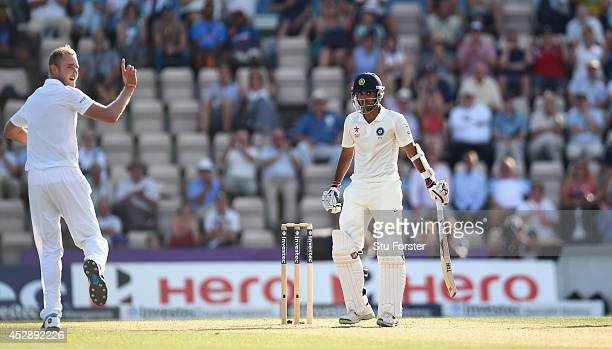 India batsman Bhuvneshwar Kumar is dismissed by England bowler Stuart Broad during day three of the 3rd Investec Test between England and India at...