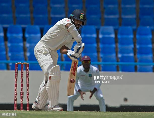 India batsman CA Pujara plays against West Indies on day one of the cricket Test match between West Indies and India July 21 2016 at Sir Vivian...