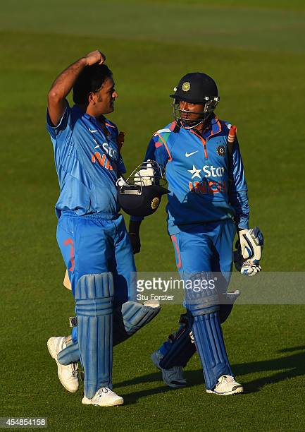 India batsman MS Dhoni and Ambati Rayudu react after the NatWest T20 International between England and India at Edgbaston on September 7 2014 in...