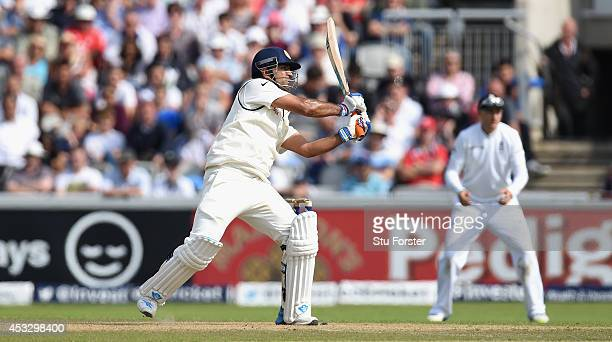 India batsman MS Dhoni hits out during day one of the 4th Investec Test match between England and India at Old Trafford on August 7 2014 in...