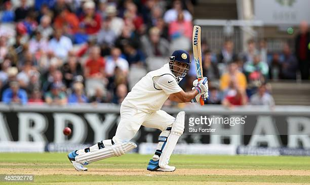 India batsman MS Dhoni picks up some runs during day one of the 4th Investec Test match between England and India at Old Trafford on August 7 2014 in...