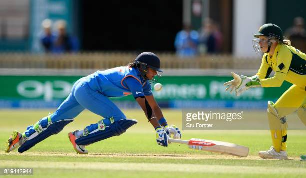 India batsman Harmanpreet Kaur dives to make her ground to reach her century during the ICC Women's World Cup 2017 SemiFinal match between Australia...