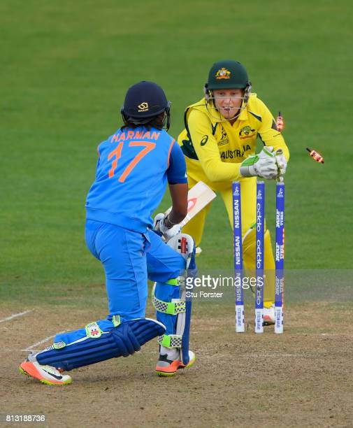 India batsman Harmanpreet Kaur is stumped by Australia wicketkeeper Alyssa Healy during the ICC Women's World Cup 2017 match between Australia and...