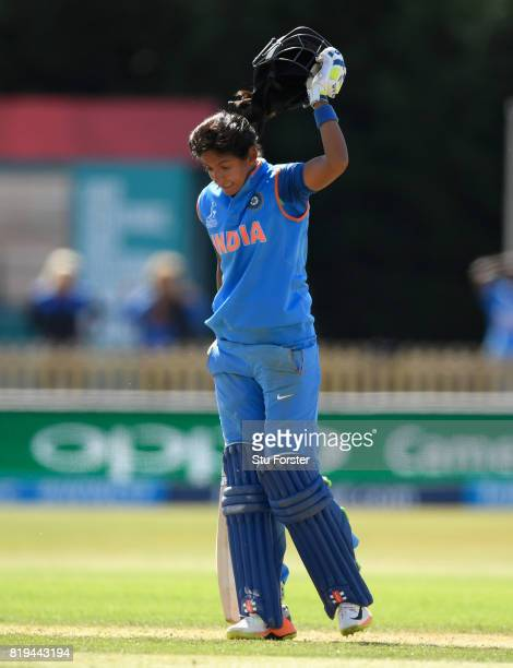 India batsman Harmanpreet Kaur reacts by throwing her helmet off onto the ground after reaching her century during the ICC Women's World Cup 2017...