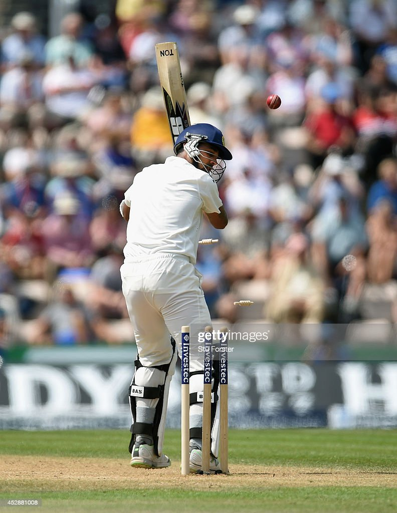 India batsman <a gi-track='captionPersonalityLinkClicked' href=/galleries/search?phrase=Murali+Vijay&family=editorial&specificpeople=5592328 ng-click='$event.stopPropagation()'>Murali Vijay</a> is bowled by England bowler Stuart Broad during day three of the 3rd Investec Test between England and India at Ageas Bowl on July 29, 2014 in Southampton, England.