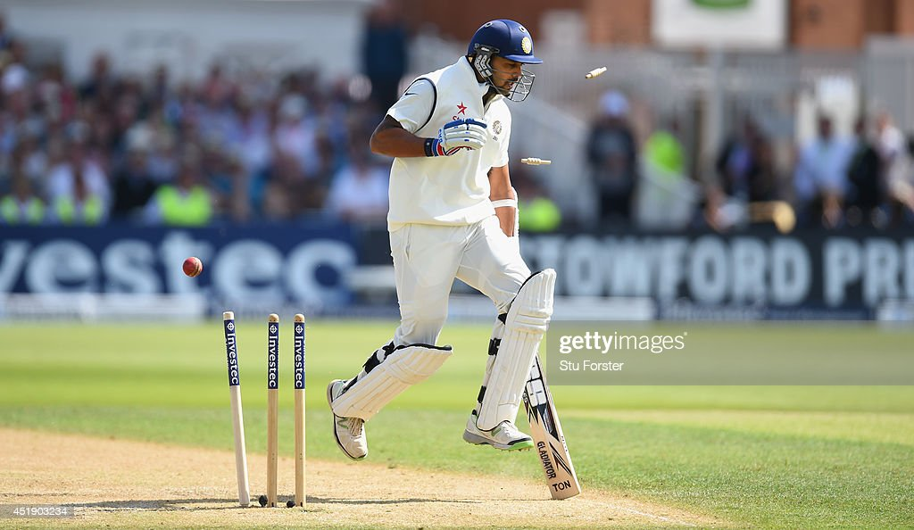 India batsman <a gi-track='captionPersonalityLinkClicked' href=/galleries/search?phrase=Murali+Vijay&family=editorial&specificpeople=5592328 ng-click='$event.stopPropagation()'>Murali Vijay</a> survives a run out attempt by England fielder Ben Stokes during day one of the 1st Investec Test Match between England and India at Trent Bridge on July 9, 2014 in Nottingham, England.