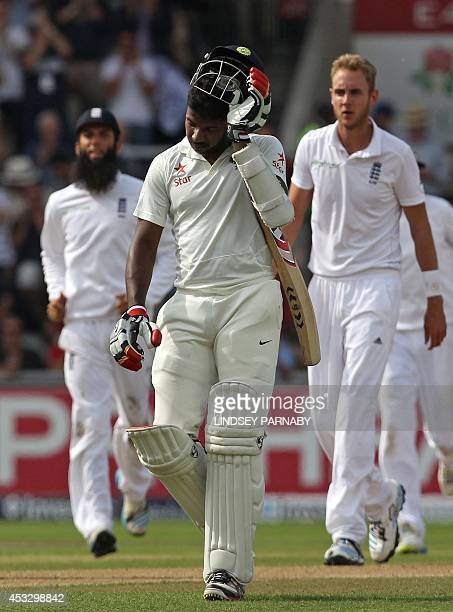 India batsman Pankaj Singh leaves the crease after being bowled by England bowler Stuart Broad Broad's sixth wicket of the Innings during play on the...