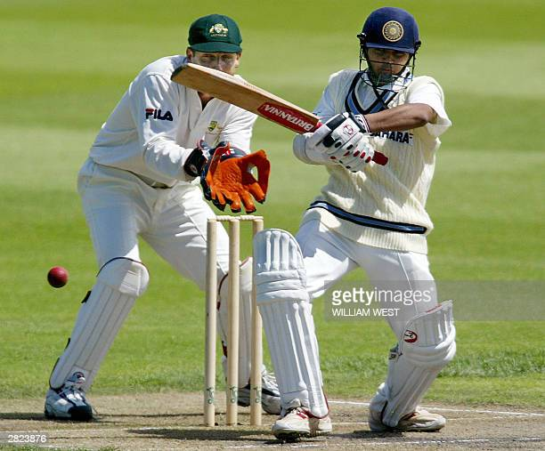 India batsman Parthiv Patel pulls a ball away to the boundary as Australia 'A' wicketkeeper Wade Seccombe looks on during their match in Hobart 20...