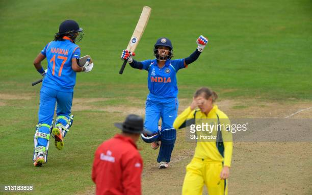 India batsman Punam Raut celebrates reaching her century as Australia bowler Jess Jonassen reacts during the ICC Women's World Cup 2017 match between...