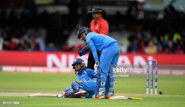 India batsman Punam Raut goes down with an injury during the ICC Women's World Cup 2017 Final between England and India at Lord's Cricket Ground on...