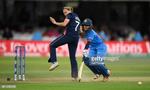 India batsman Punam Raut makes her ground despite the attentions of Laura Marsh during the ICC Women's World Cup 2017 Final between England and India...