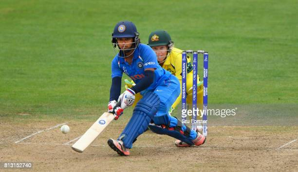 India batsman Punam Raut plays a scoop shot to the boundary watched by Australia wicketkeeper Alyssa Healy during the ICC Women's World Cup 2017...
