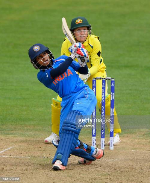 India batsman Punam Raut pulls a ball to the boundary watched by Australia wicketkeeper Alyssa Healy during the ICC Women's World Cup 2017 match...