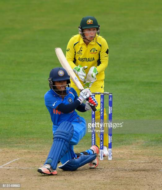 India batsman Punam Raut sweeps a ball to the boundary watched by Australia wicketkeeper Alyssa Healy during the ICC Women's World Cup 2017 match...