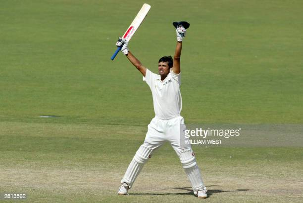 India batsman Rahul Dravid celebrates after hitting the winning runs against Australia on the final day of the second Test Match being played in...