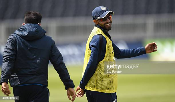 India batsman Ravindra Jadeja and Virat Kholi share a joke during India nets nets ahead of the 4th Test match between England and India at Old...