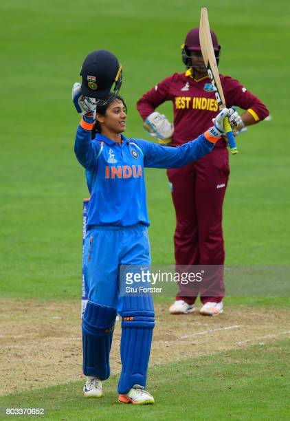 India batsman Smriti Mandhana celebrates her century during the ICC Women's World Cup 2017 match between West Indies and India at The County Ground...