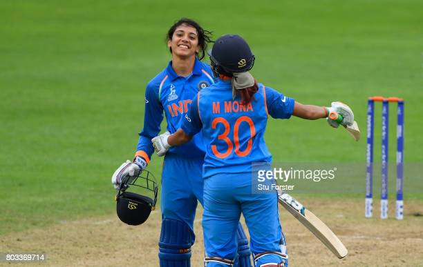 India batsman Smriti Mandhana celebrates her century with Mona Meshram during the ICC Women's World Cup 2017 match between West Indies and India at...