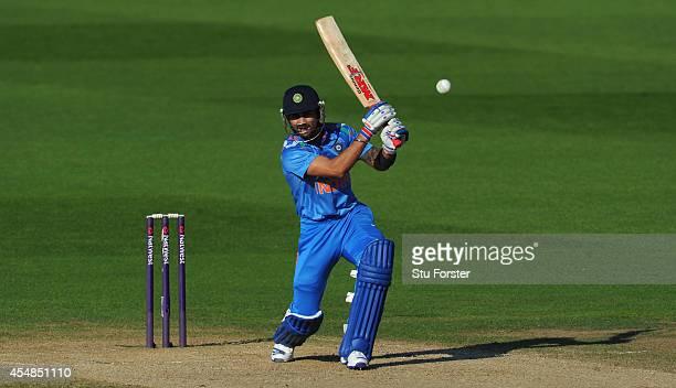 India batsman Virat Kholi hits out during the NatWest T20 International between England and India at Edgbaston on September 7 2014 in Birmingham...