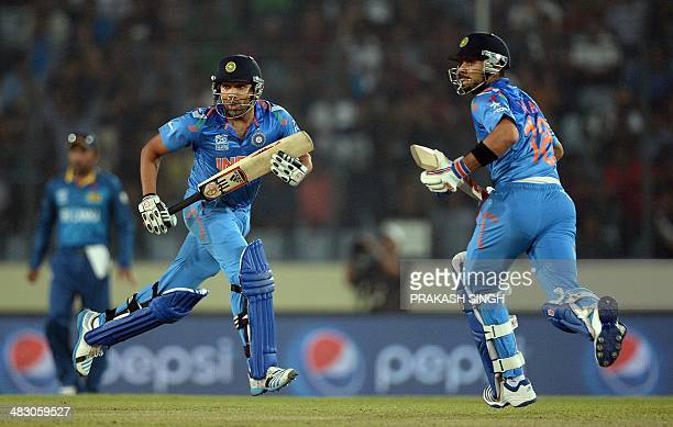 India batsman Virat Kohli and Rohit Sharma run between the wickets during the ICC World Twenty20 final cricket match between India and Sri Lanka at...